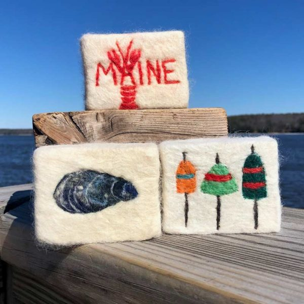 Alpaca Fleece, Felted Soaps with Red, Maine Lobster, Clam Shell and buoys.