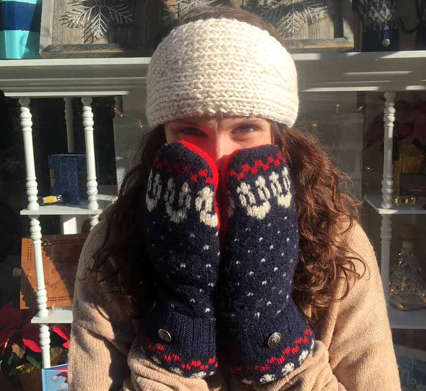 Marissa wearing recycled sweater, fleece-lined mittens
