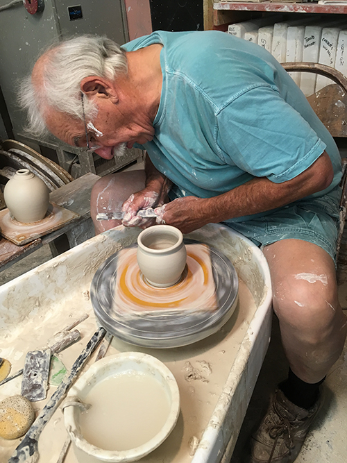 Joe Devenney throwing pottery
