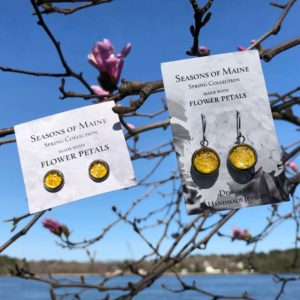 Yellow, Rose, Flower Petal Earrings, hanging in a tree by the ocean.