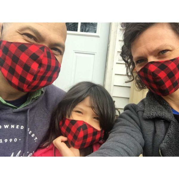 Maine Made Mask in Buffalo Plaid for the whole family. Dad, daughter and mom pictured.