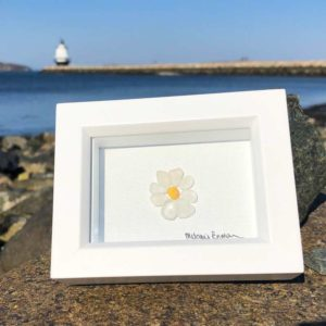 Daisy made from Sea Glass in frame.