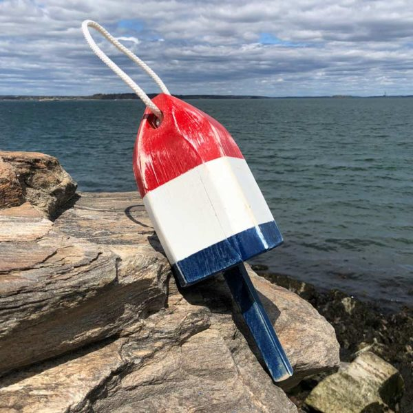 Small, Distressed, Red, White and Blue Buoy.